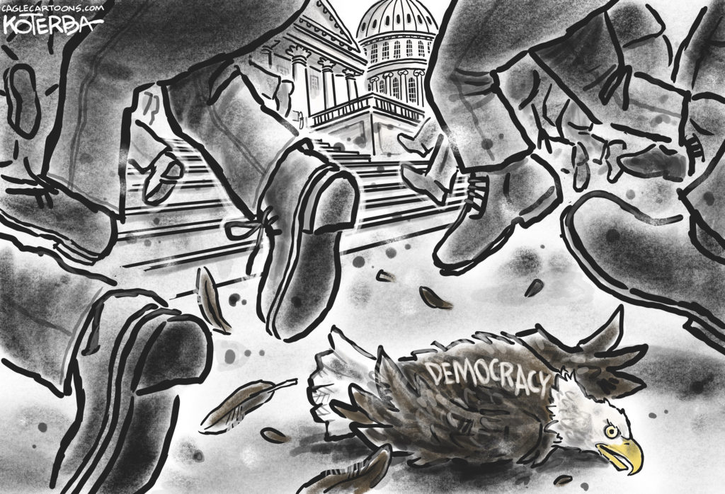 """Many feet headed to Capitol Hill and trampling an eagle with the word """"democracy""""."""
