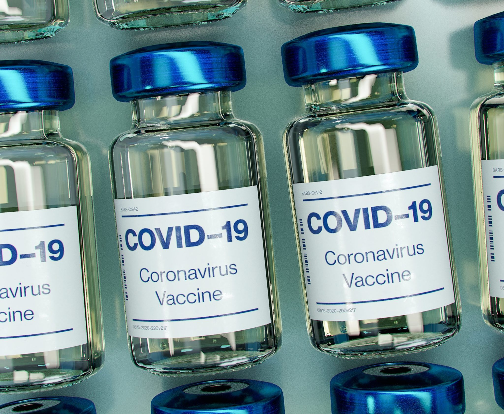 small glass bottles labelled 'covid-19'