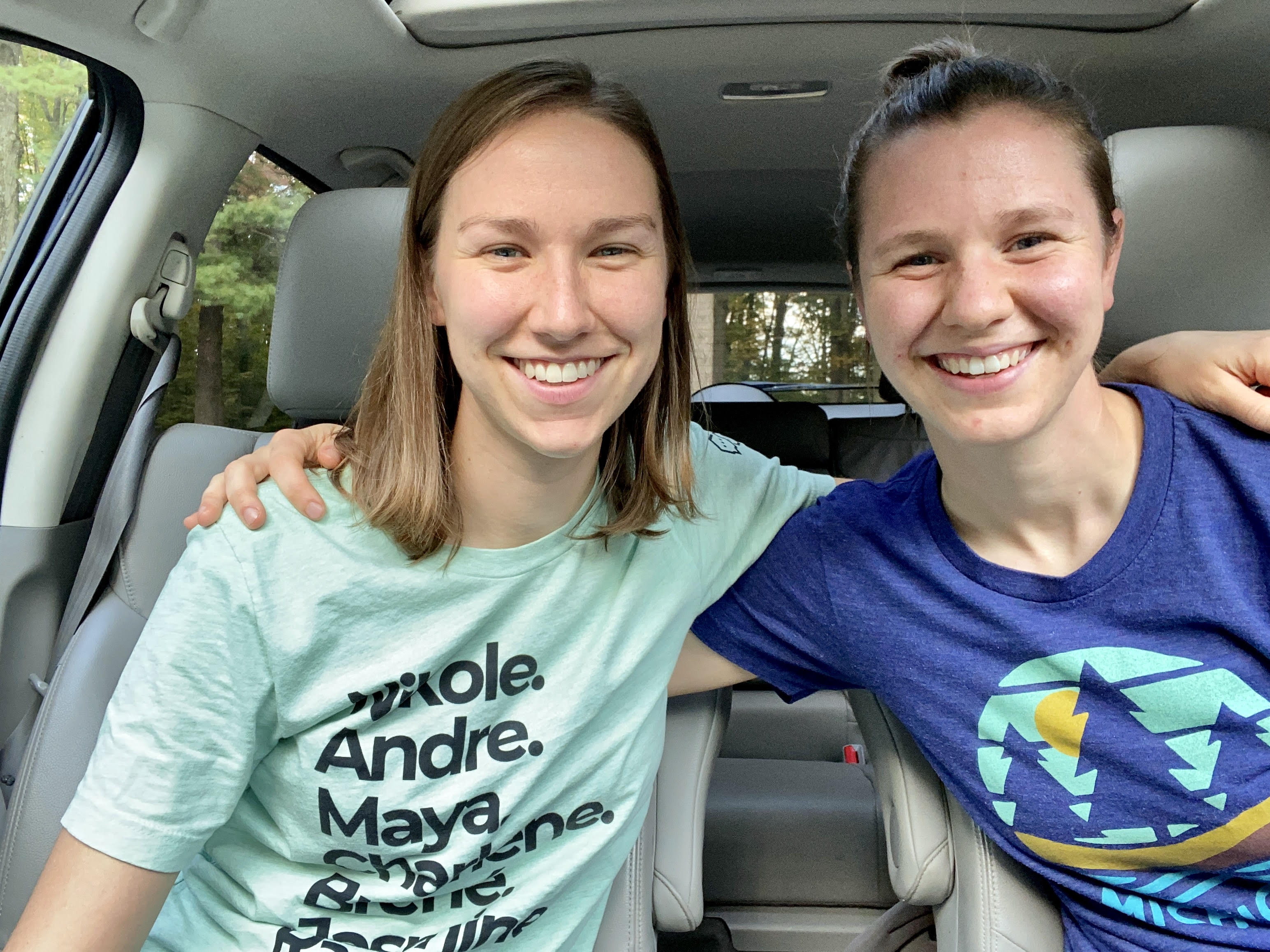 Two girls in a car.