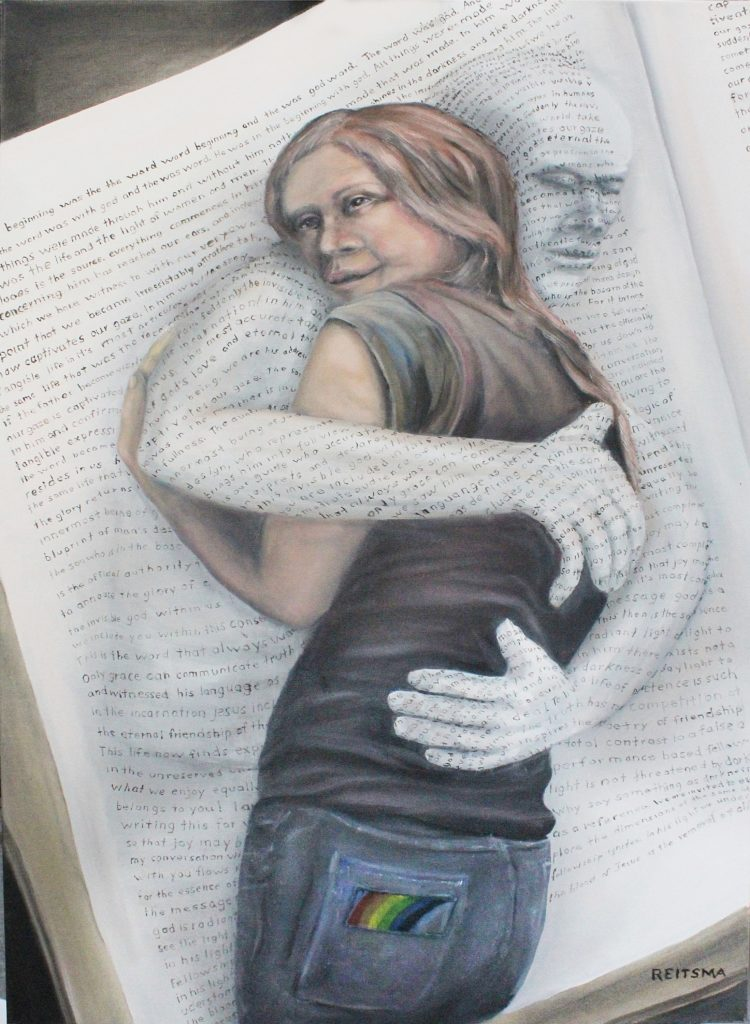 a printed page reaching out to hug a girl.