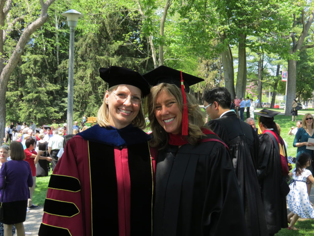 two women in academic garb