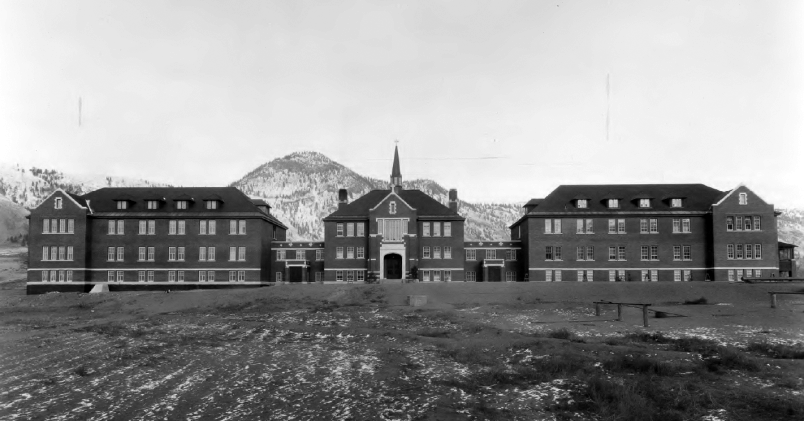 black and white photo of long buildings