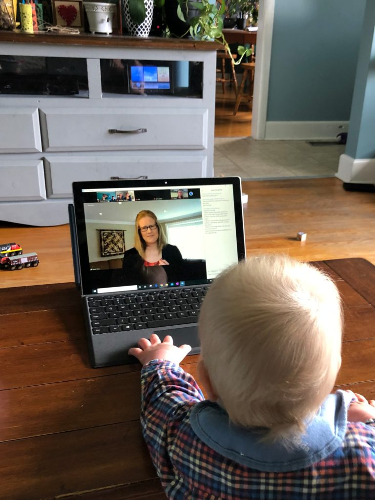 a baby watching Cara preach on Zoom