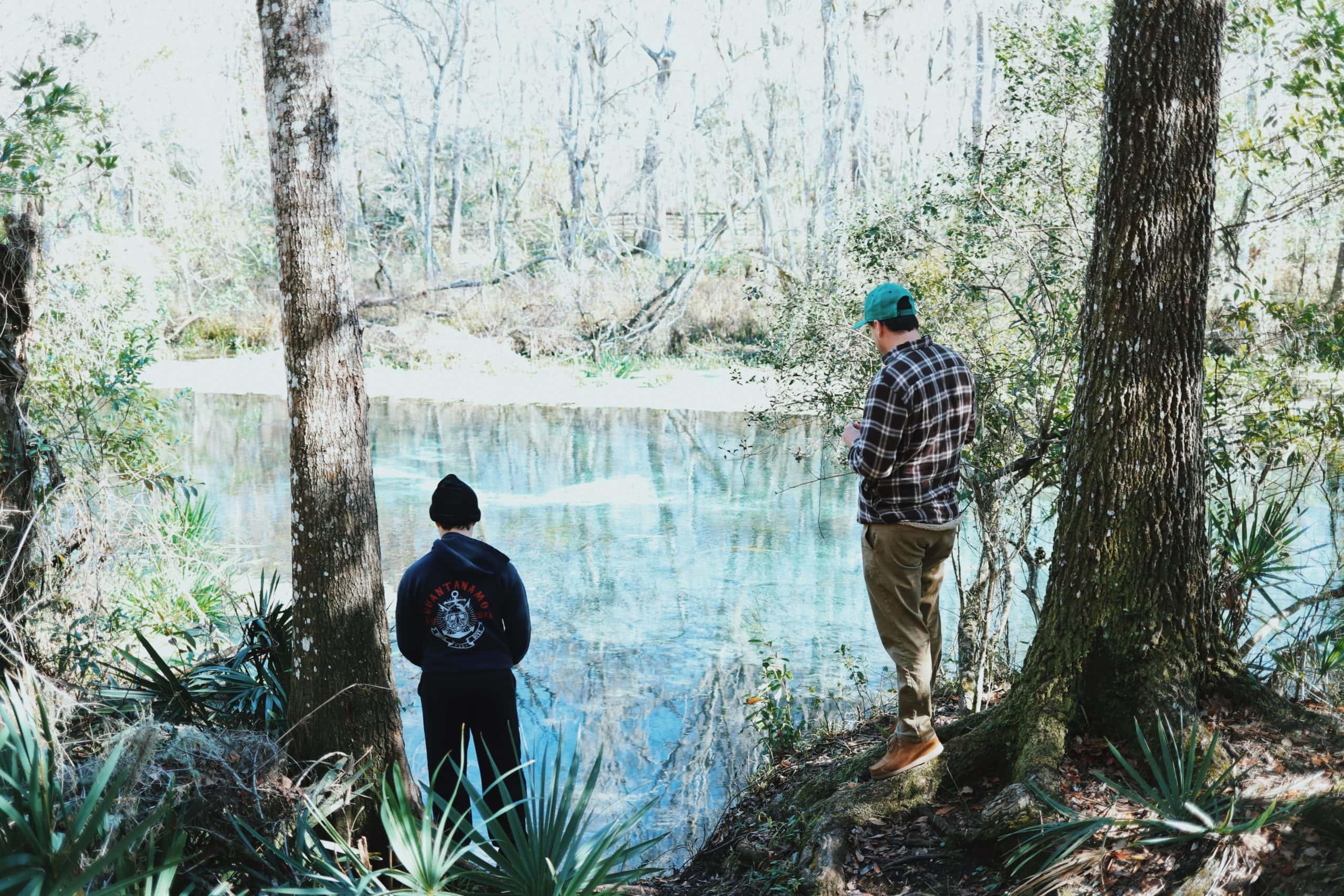 a man and a boy at a lake