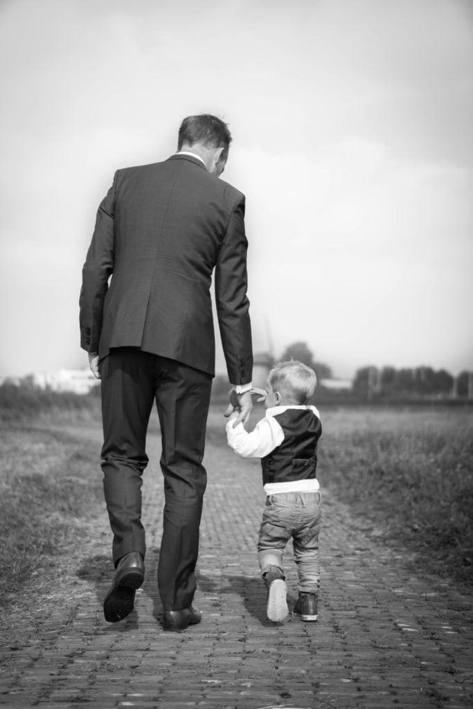 a man walking a small boy