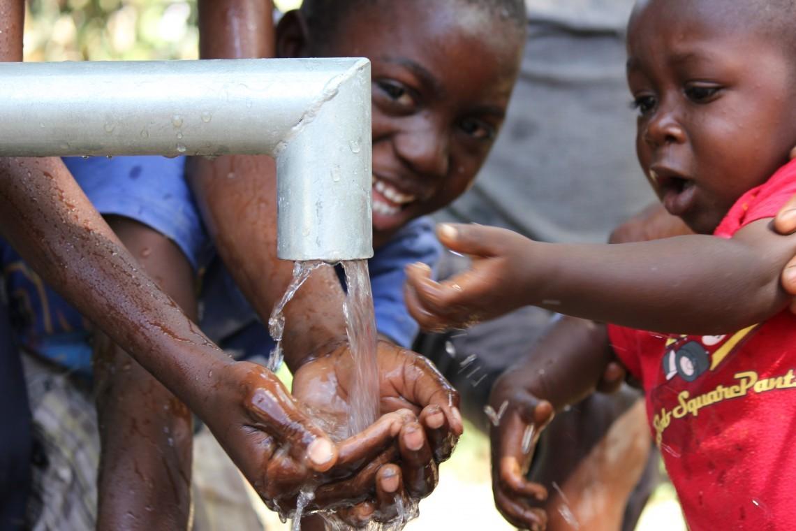 Children in Iladan, Haiti, enjoying safe running water for the first time.