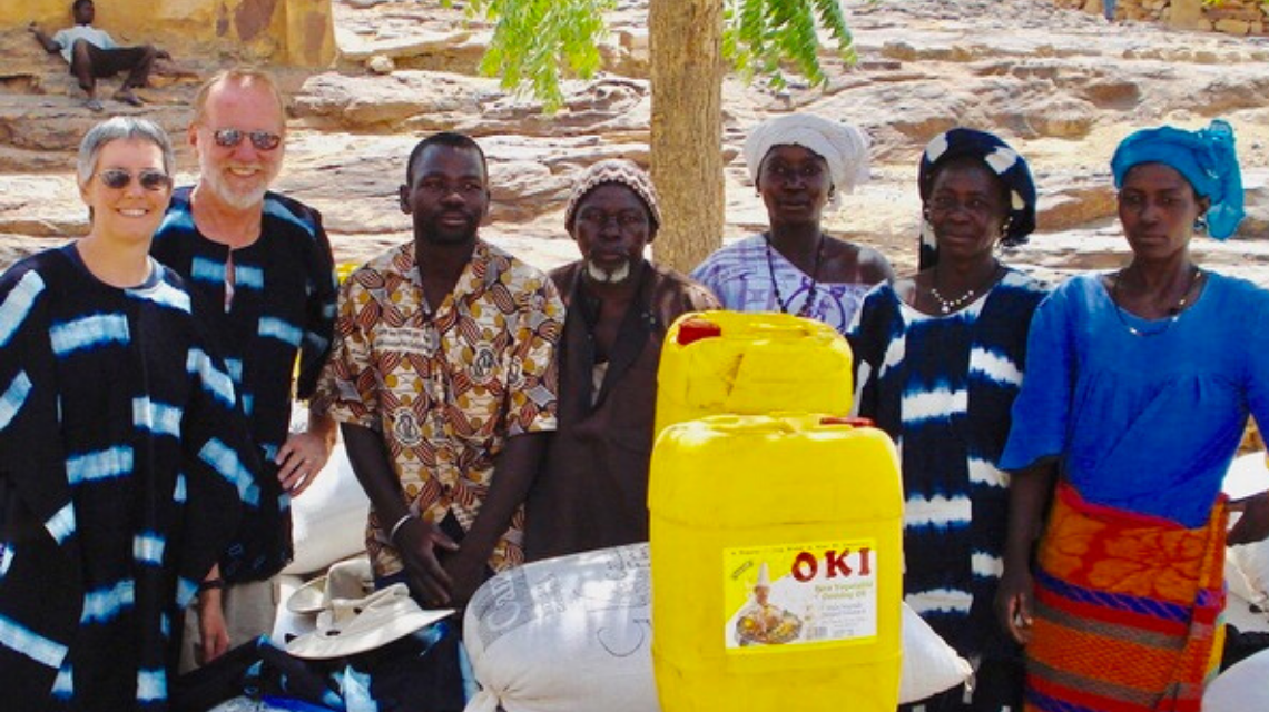 Retirees Mike and Colleen Hoyer with local partners while volunteering in Mali with World Renew.
